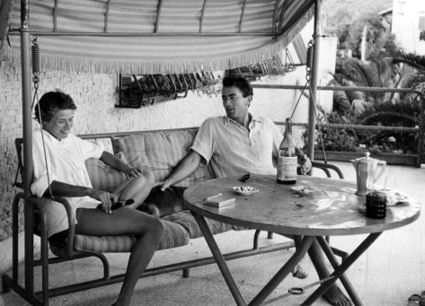 Ingrid Bergman and Gregory Peck enjoy a relaxing moment on a swing in Italy, Santa Marinella 1952, photographed by David Seymour, Magnum Photos