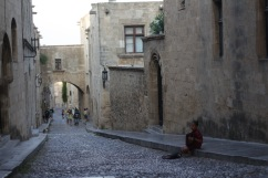 This is the old town in Rhodes with its Medieval architecture and stone-paved roads.