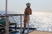 A tourist observes the vast blue sea on our way from Rhodes to the island of Symi.